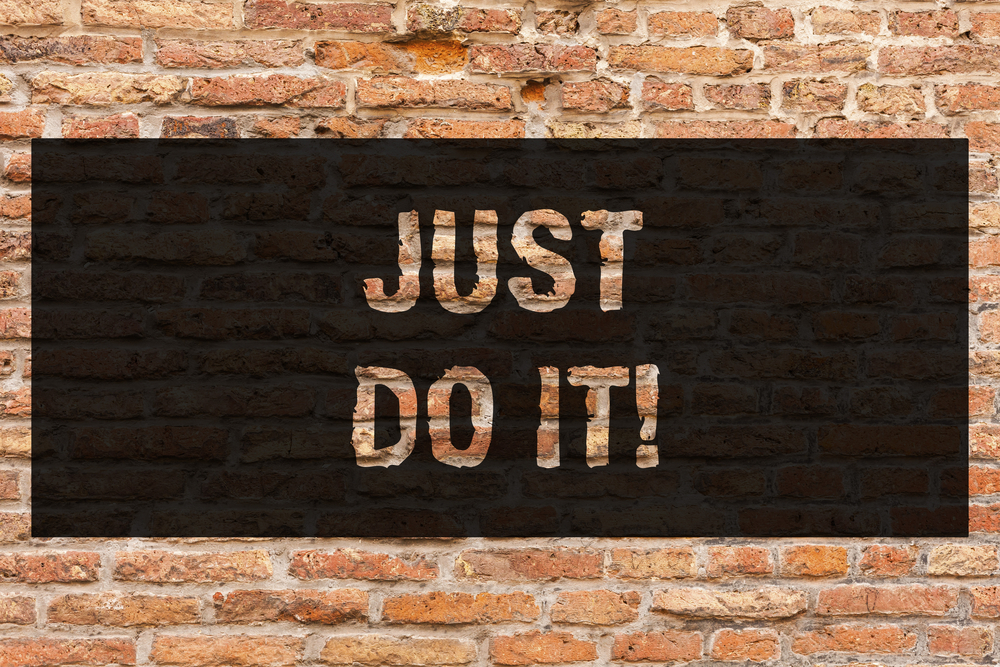 Writing note showing Just Do It. Business photo showcasing Motivation for starting doing something Have discipline Brick Wall art like Graffiti motivational call written on the wall